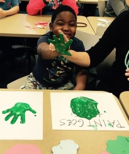 One of our kiddos getting messy while creating a special gift for his mother!